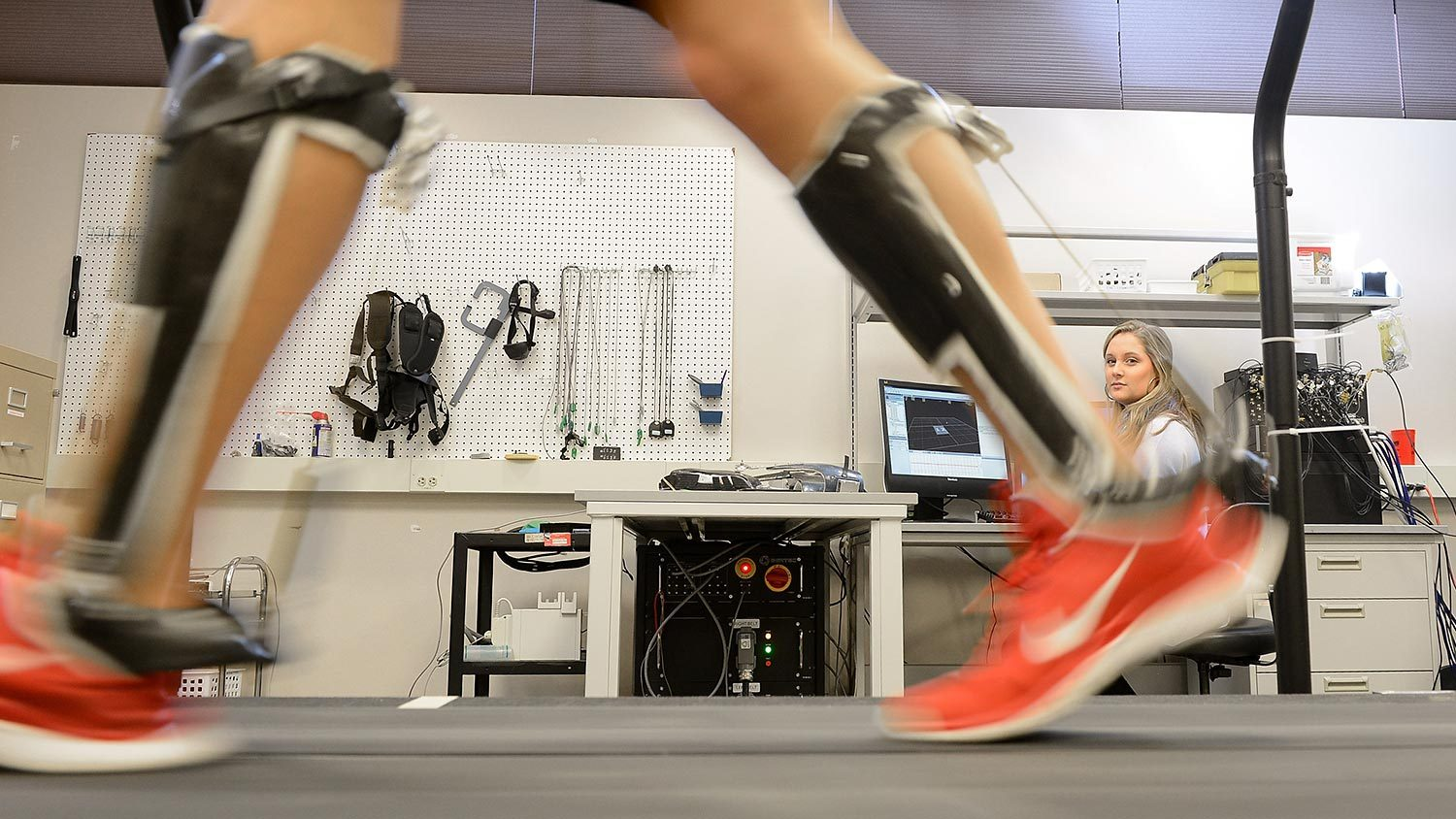 Researcher studies subject in the gait lab