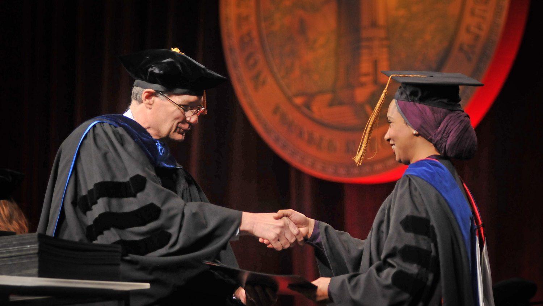 Provost Warwick Arden congratulates a graduate.