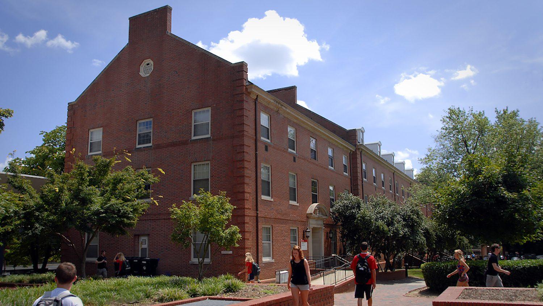 Students walk past Alexander Hall.