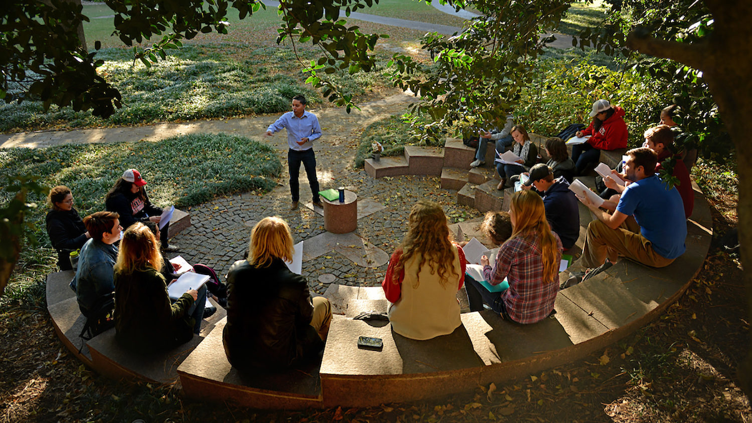 professor talking during outdoor lecture