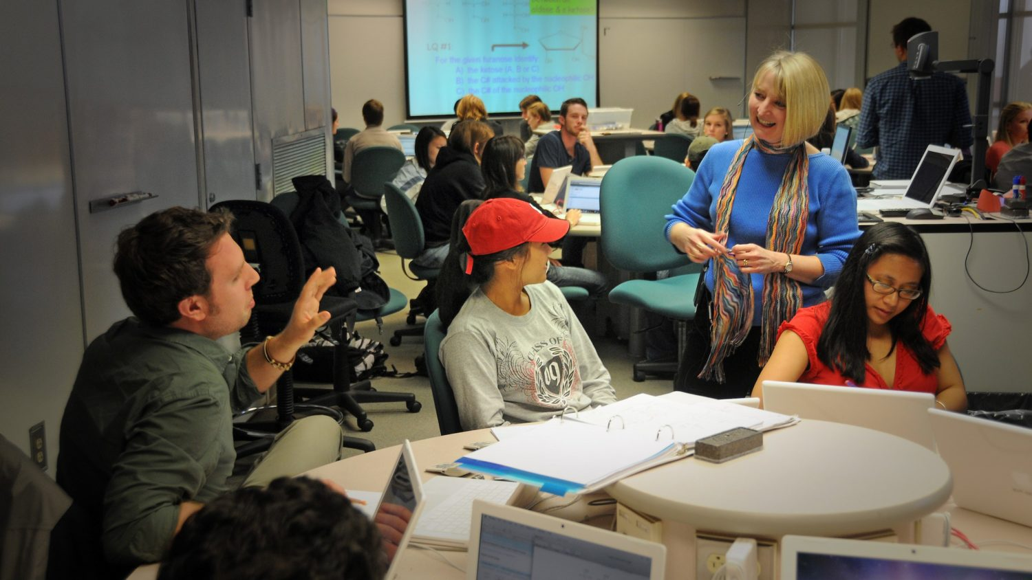Student asks a question of COS professor Kay Sandberg in Scale-Up class.