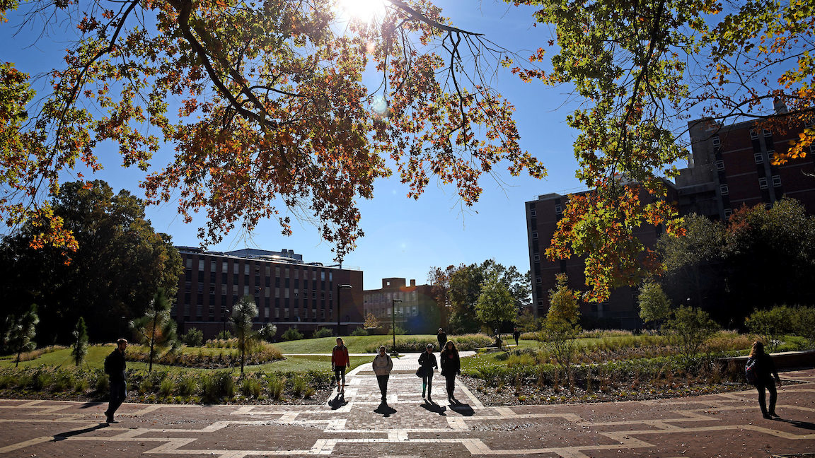 Students walk to class on North Campus at the Brickyard, near the space where Harrelson Hall used to be.