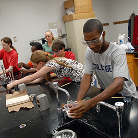 High school students work on a chemistry experiment in the College of Textiles during the STEP program.