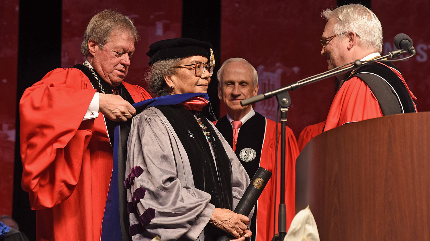 Board of Trusteess chair Jimmy Clark honors Marian Wright Edelman with an honorary doctorate.