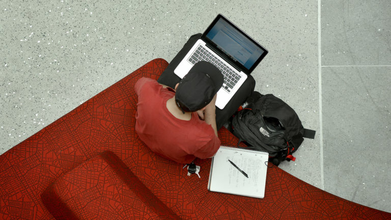 Student works on his lap top in Talley Student Union.