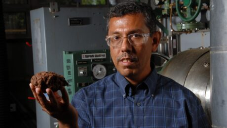 CNR's Hasan Jameel and a lump of woody material pretreated to create fuel.